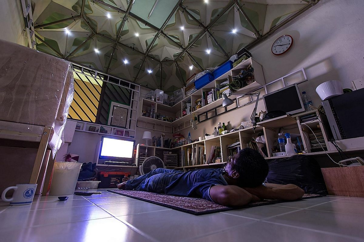 Mr Fairuz, 35, built this ceiling structure in his room. Made of polyester pipes and corrugated boards, it was inspired by the Esplanade. At night, at the flip of a switch, his ceiling is transformed into a starry sky. Mr Fairuz was diagnosed with ma