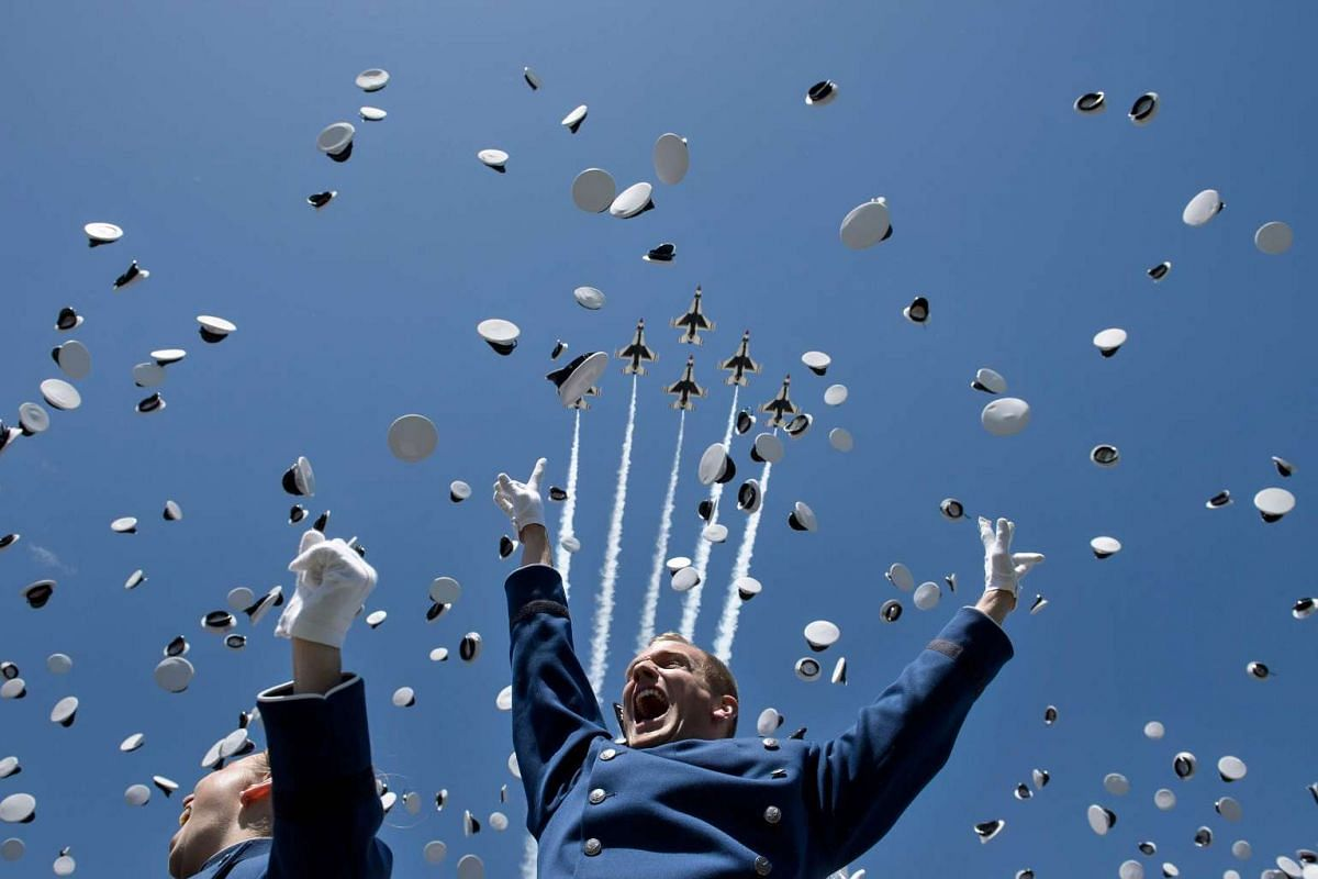 Cadets celebrate after taking their oath during a graduation ceremony at the US Air Force Academy's Falcon Stadium June 2, 2016 in Colorado Springs, Colorado. PHOTO: AFP