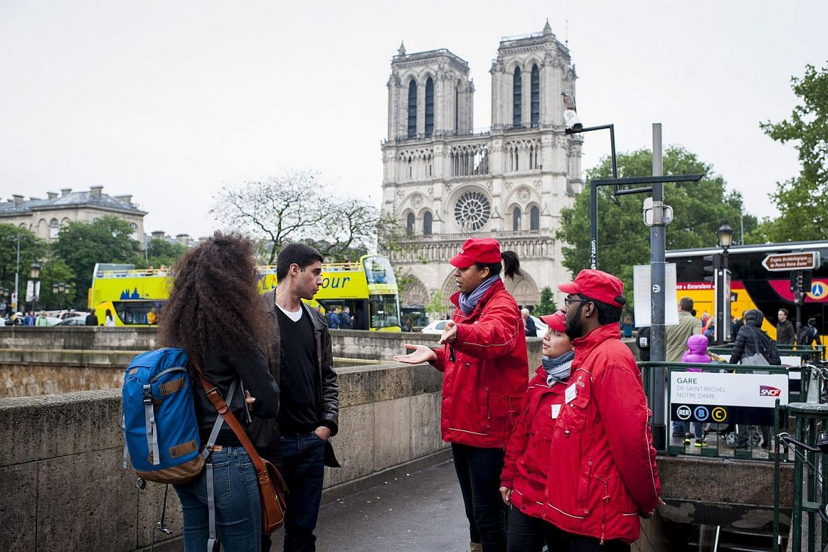 Staff members of RATP, France's national rail service, inform commuters that the train station Saint Michel is closed because of Seine river floodwaters following heavy rainfalls in Paris on June 2.