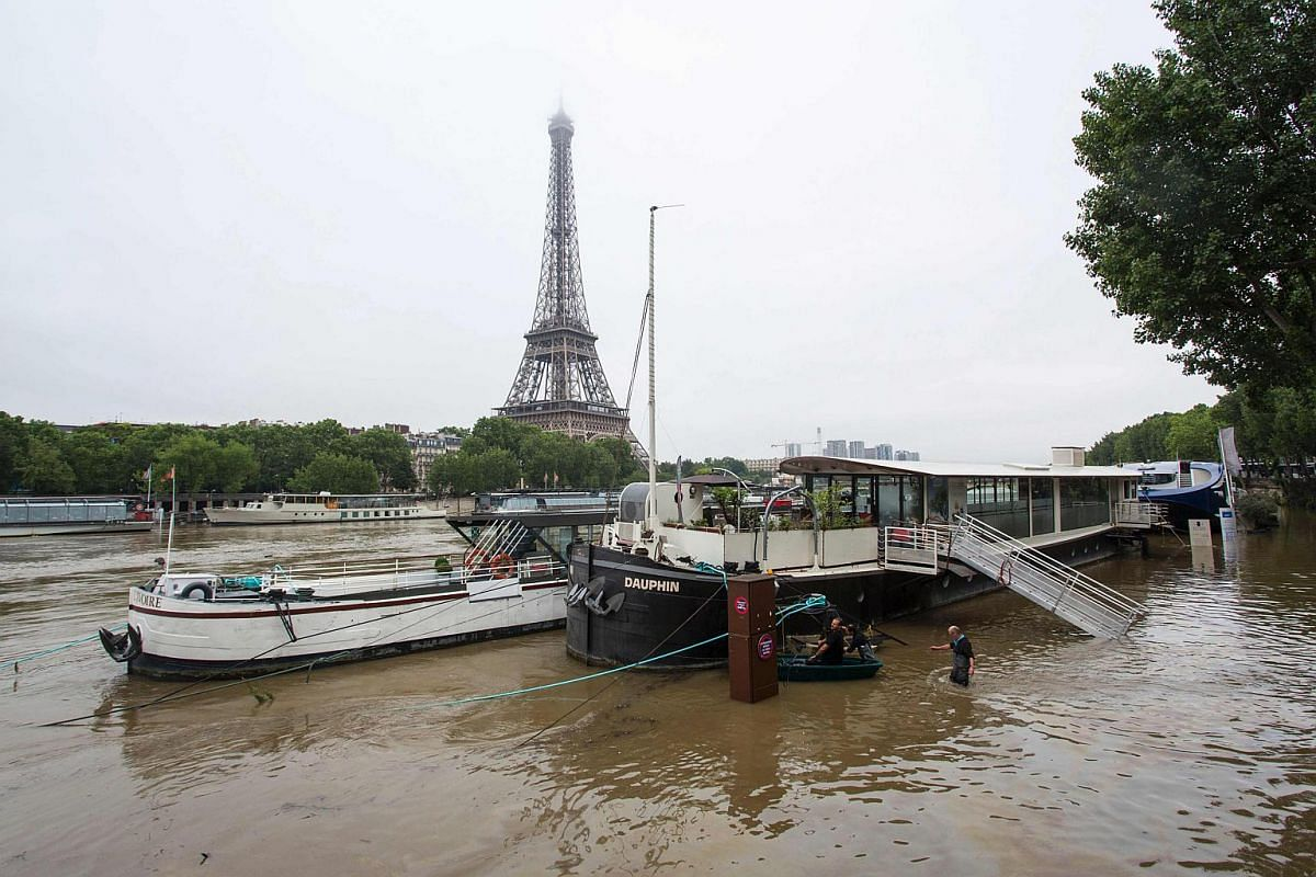 Boats are seen on the river Seine in front of the Eiffel tower, after the banks of the river have been flooded following heavy rainfalls in Paris on June 2.