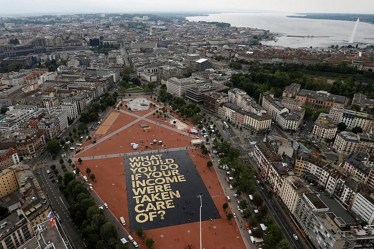A 8,000 sq m poster, on the Plainpalais square in Geneva, crowdfunded by the committee for the initiative for an unconditional basic income in Switzerland. The country is holding a referendum on the proposal tomorrow.