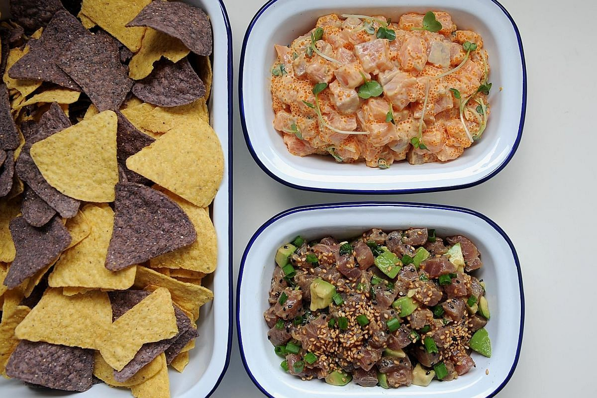 Tortilla chips, salmon poke (left) and tuna poke (below).