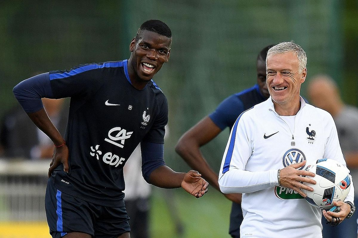France head coach Didier Deschamps (right) jokes with midfielder Paul Pogba at the end of a training session in Clairefontaine as part of the national team's preparation for Euro 2016.