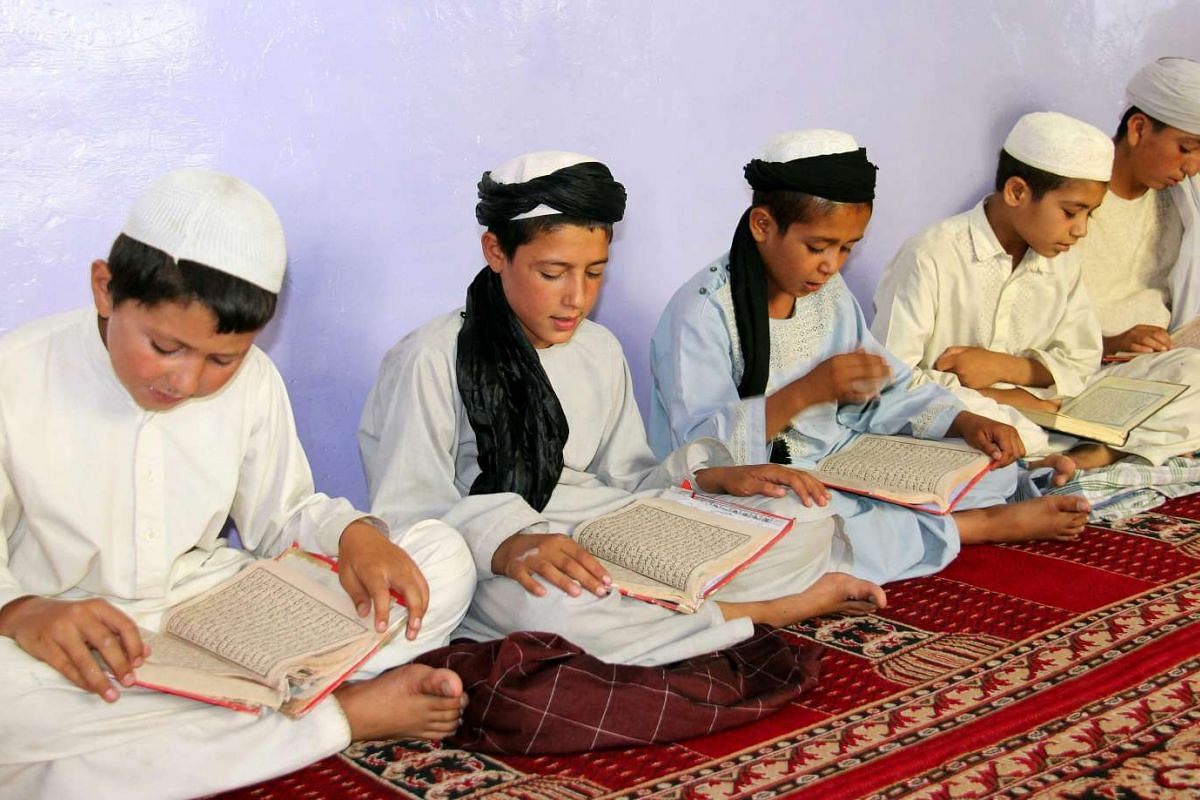 Afghan boys read the Quran ahead of the Muslim holy fasting month of Ramadan in Kandahar, Afghanistan, on June 5, 2016.