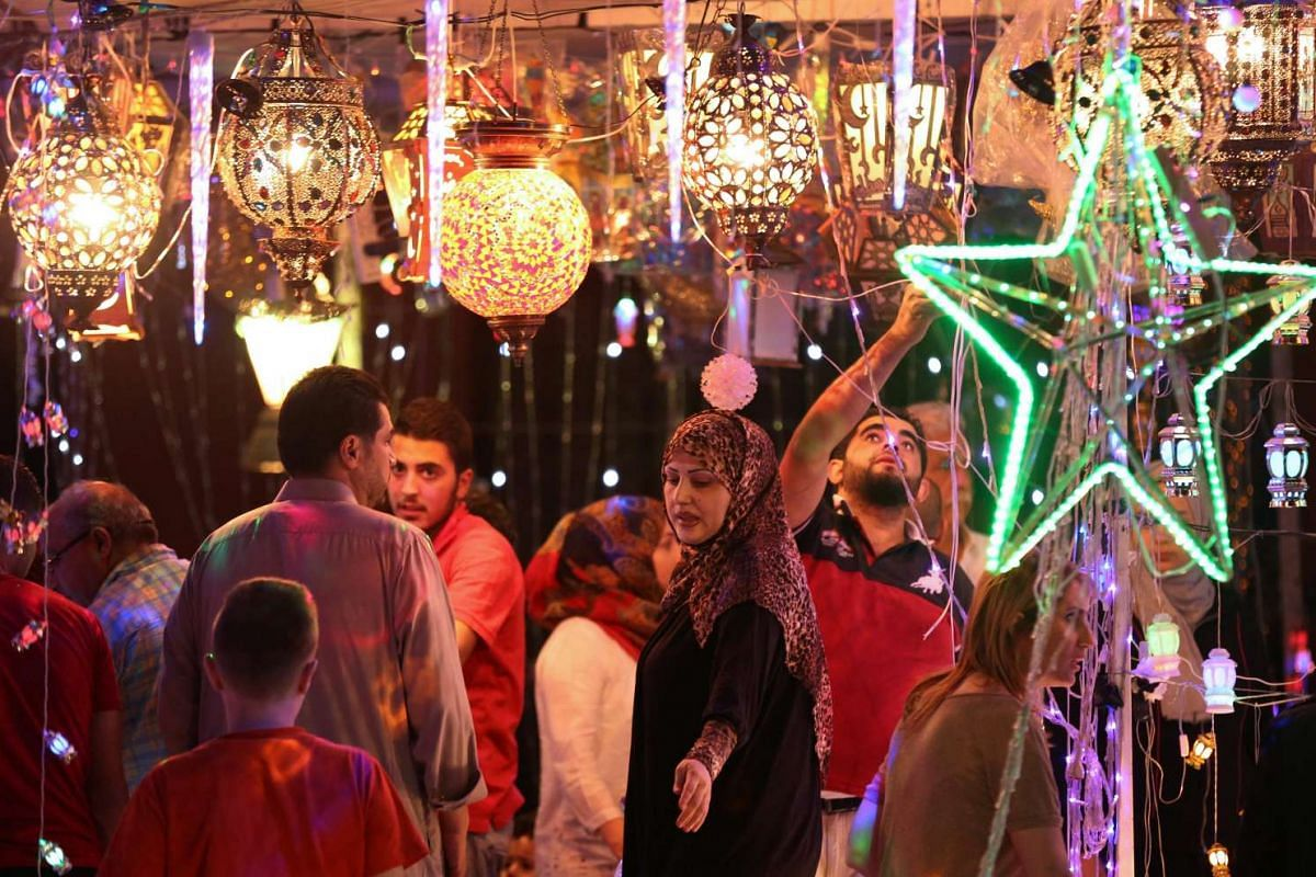 "Jordanians shop for traditional lanterns known in Arabic as ""Fanous"" at a market in the capital Amman on June 5, 2016, as the fasting month begins."