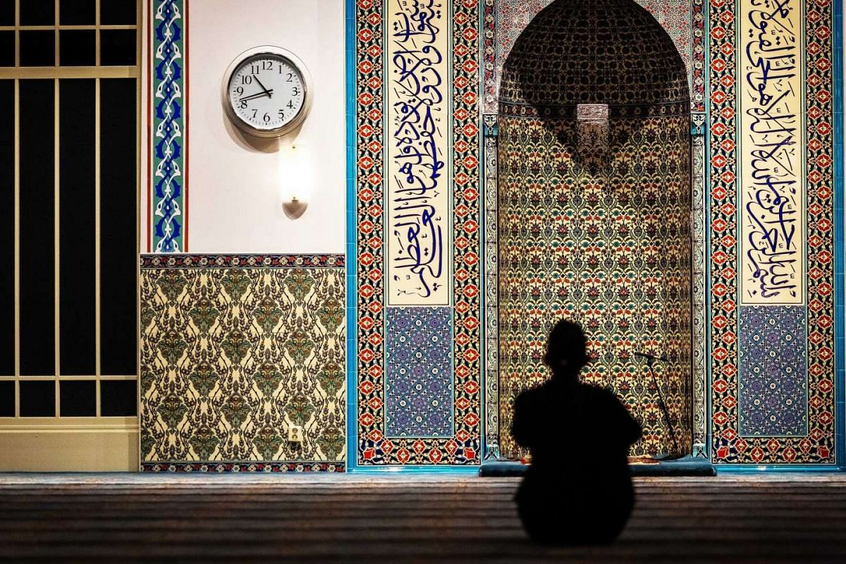 A man performing an evening prayer called Tarawih, the night before the start of the holy fasting month of Ramadan, at the Mevlana mosque in Rotterdam, the Netherlands, on June 5, 2016.