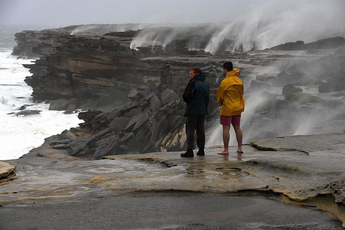 Onlookers watching massive swells at Cape Solander, in Sydney, NSW, Australia, on June 5.