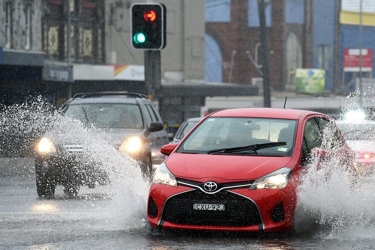 Vehicles drive through a partially flooded Paramatta Road in Sydney, NSW, Australia, on June 5.