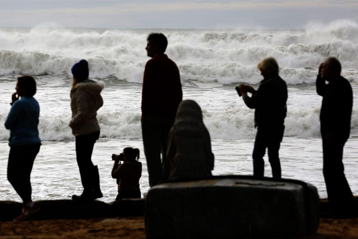 People looking at the damage caused by heavy rain and storms at Collaroy in Sydney's Northern Beaches, NSW, Australia, on June 6.