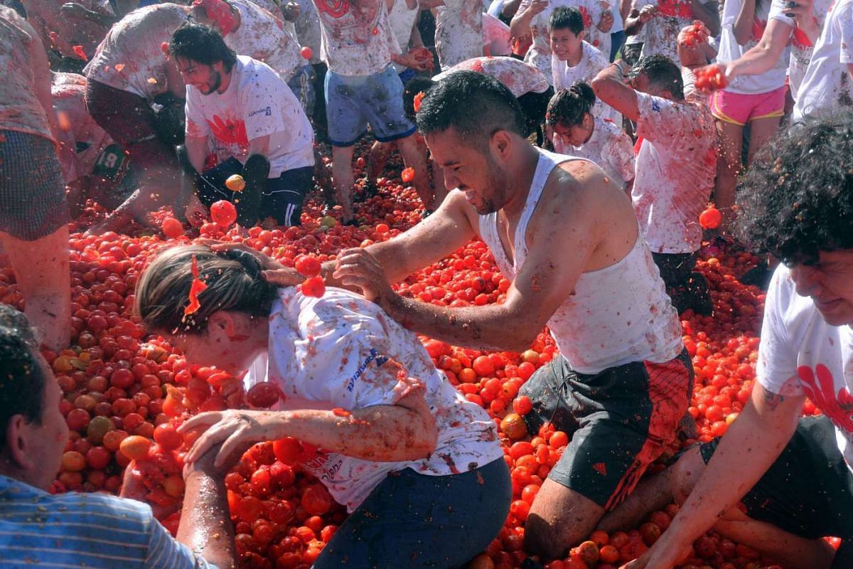 """People participate in the tenth annual tomato fight festival, known as """"tomatina"""", in Sutamarchan, Boyaca department, Colombia, on June 5, 2016."""