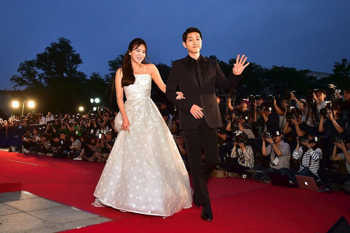 South Korean actor Song Joong-Ki (right) and actress Song Hye-Kyo walk on the red carpet of the 52nd annual BaekSang Art Awards in Seoul on June 3.