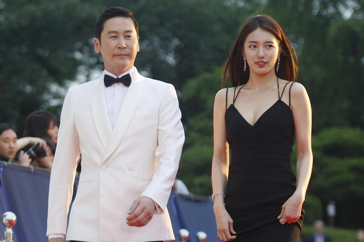 South Korean comic Shin Dong-Yup (left) and South Korean girl group miss A member, singer and actress Bea Soo-Ji (right) arrive for the 52nd annual Baeksang Art Awards at the Kyunghee University in Seoul, South Korea, on June 3.