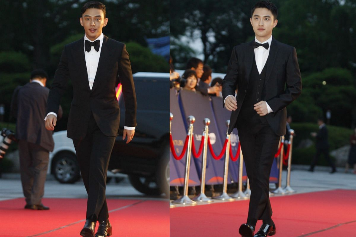South Korean actor Yoo Ah-In (left) and Chinese-South Korean boy group EXO member and actor Do Kyung-Soo (right) arrive for the 52nd annual Baeksang Art Awards at the Kyunghee University in Seoul, South Korea, on June 3, 2016.