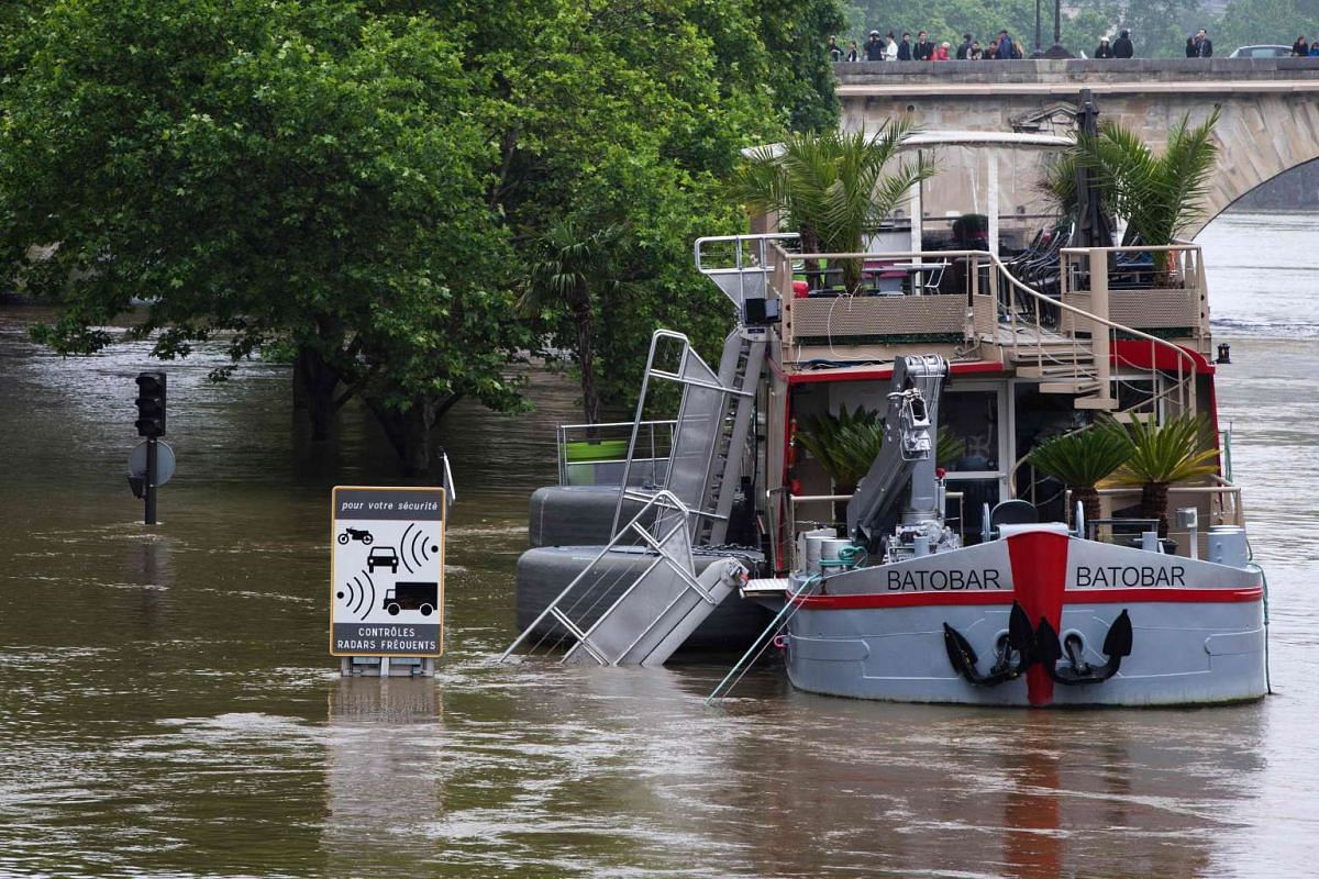 This photo taken on June 5 shows the Batobar lounge boat docked in the flooded Seine River in Paris.