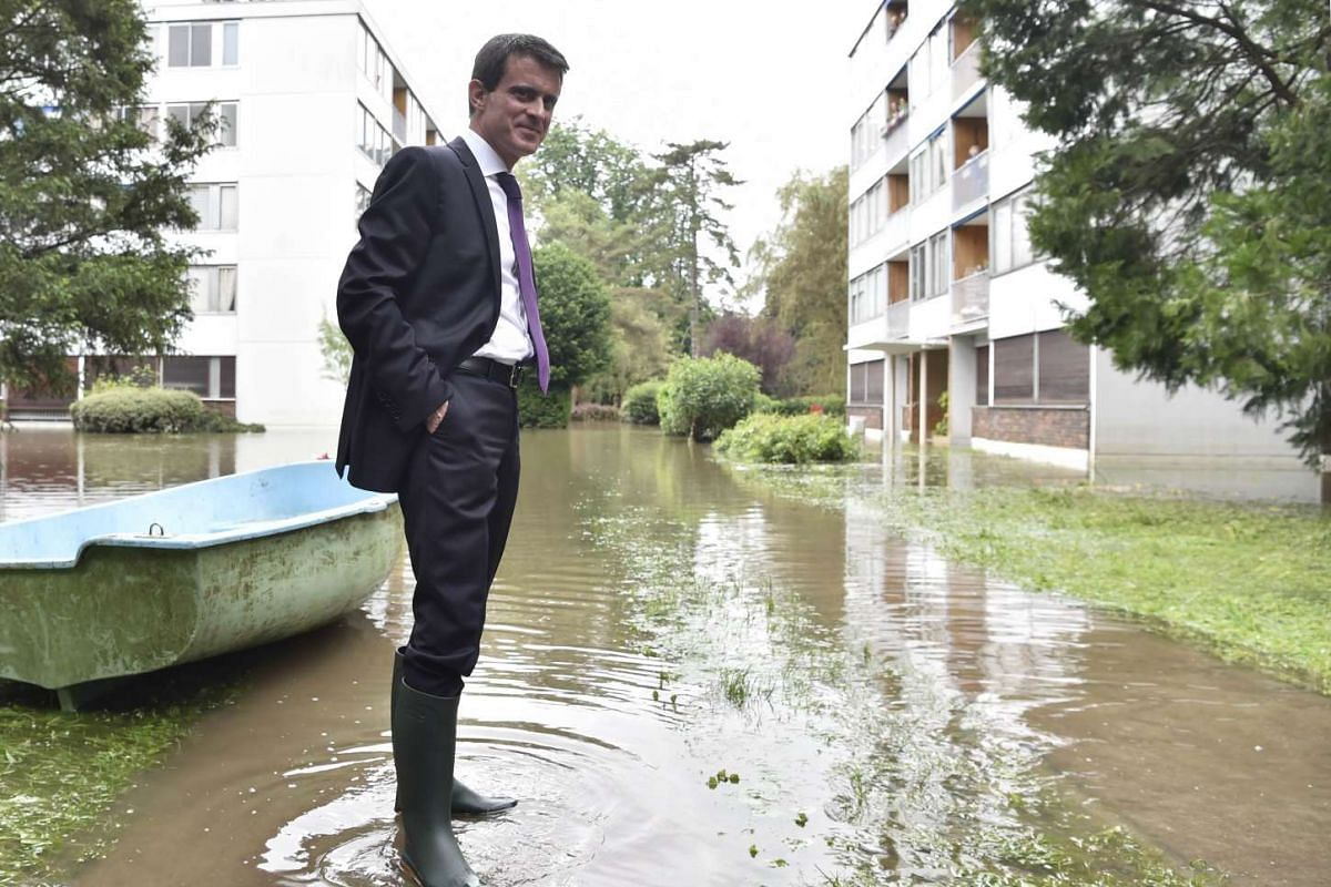 French Prime Minister Manuel Valls wore boots to visit the flooded areas in Crosne, a southern Paris' suburb, on June 4 .