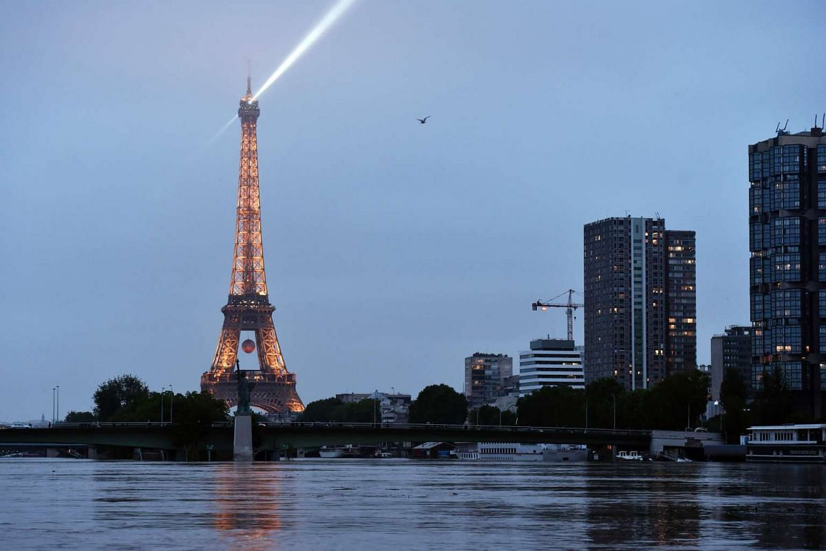 A photo taken on June 3 shows water rising near the Eiffel Tower in Paris.