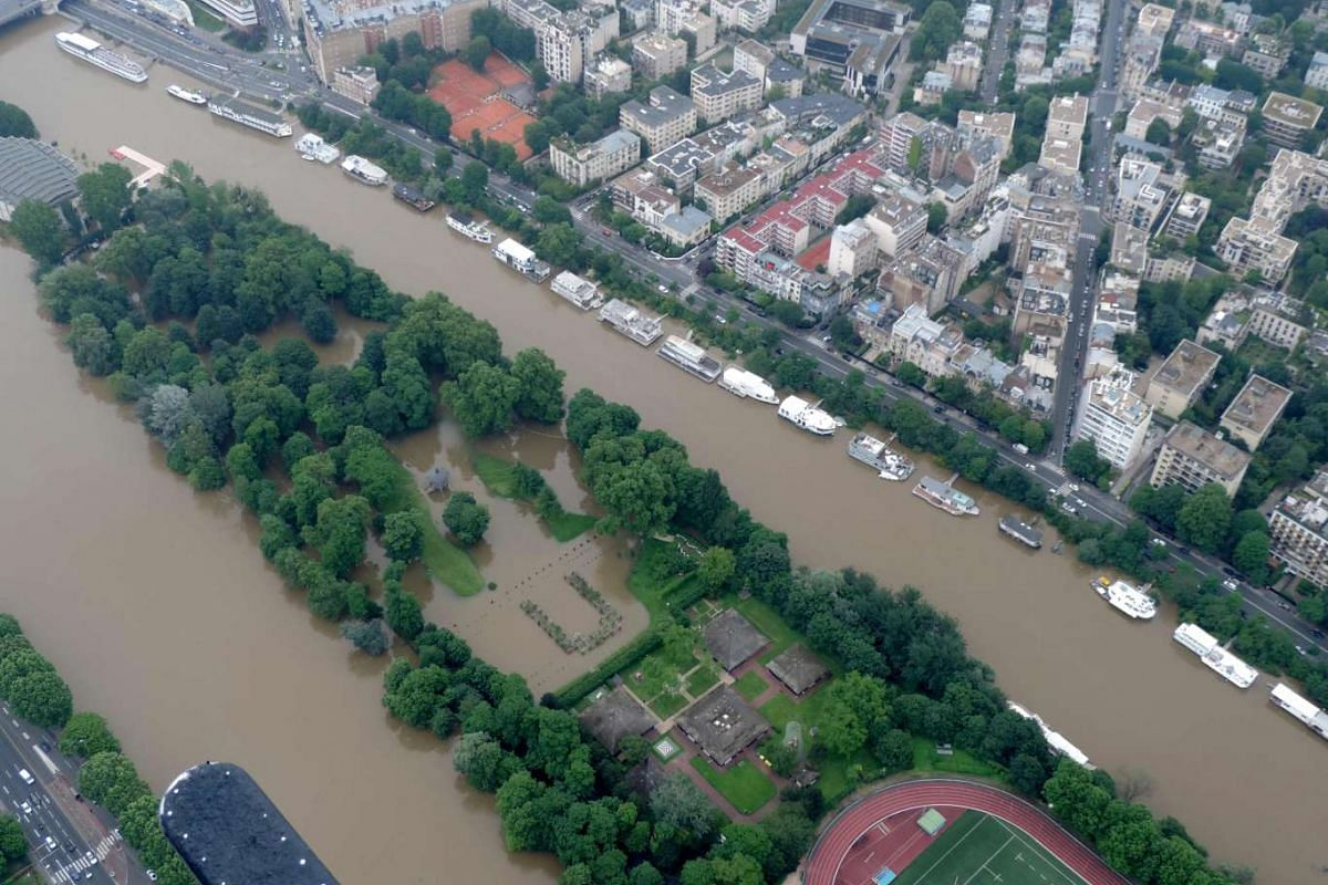 This aerial photo taken on June 4 by the French air force shows the Lebaudy Parc in Puteaux, west of Paris, flooded by the River Seine after it burst its banks near the pont de Neuilly bridge.