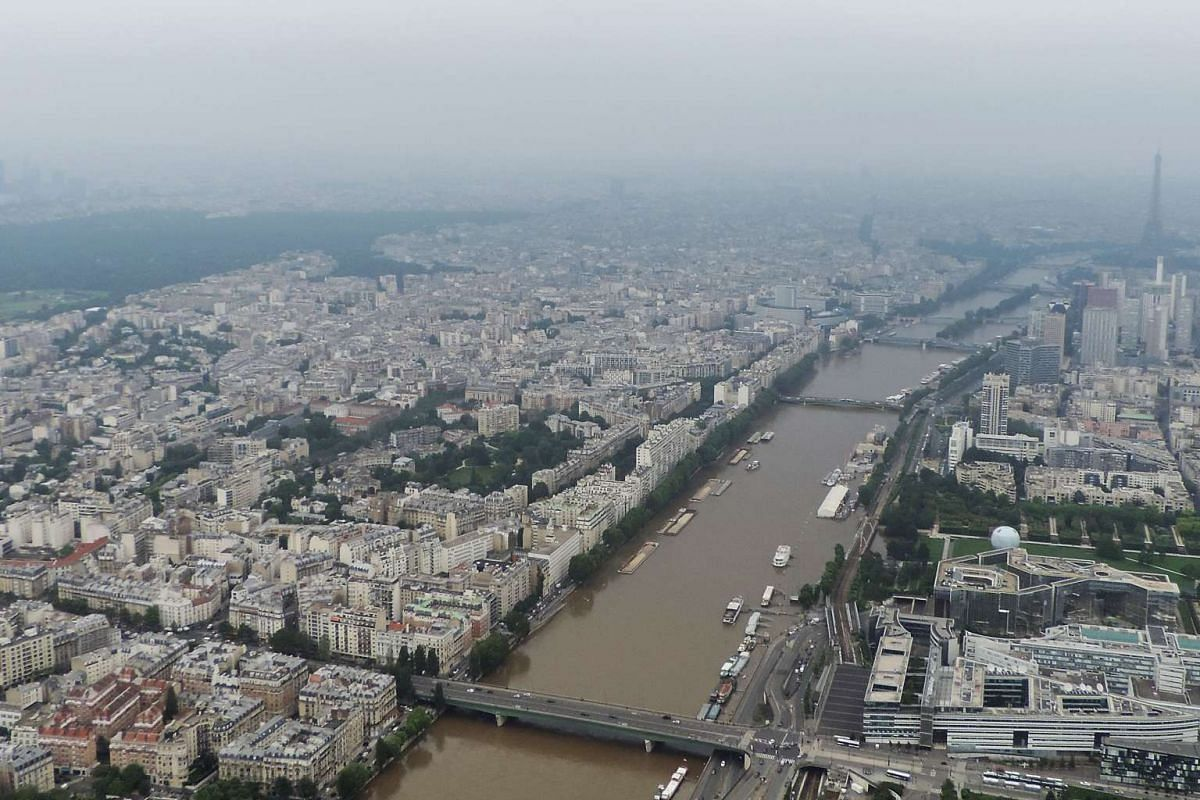 This aerial photo taken on June 4 by the French air force shows the River Seine after it burst its banks near the Andre Citroen park in the south-west district of Paris, with the Eiffel Tower rear right.