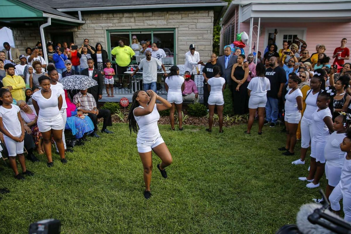 Girls dance during a neighbourhood celebration of the late Muhammad Ali at his boyhood home in Louisville, Kentucky, USA, on June 6, 2016.