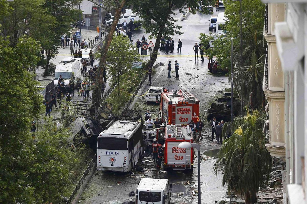 Fire engines stand beside a Turkish police bus, which was targeted in a bomb attack in a central Istanbul district, Turkey, on June 7, 2016.
