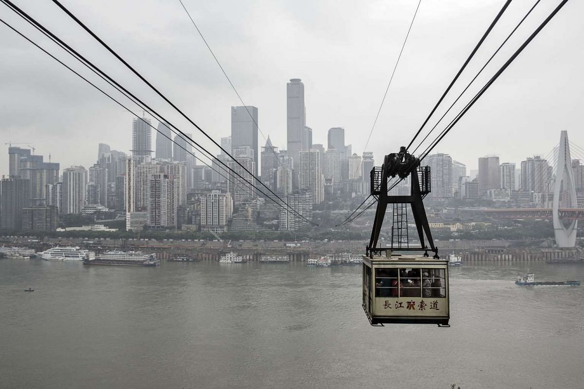 A Yangtze River Cableway cable car travels across the river in Chongqing, China, on April 12, 2016.