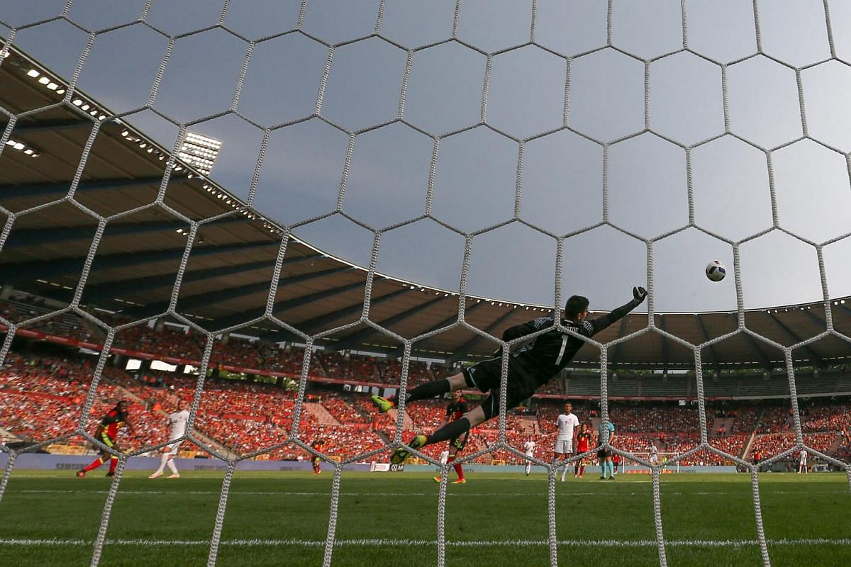 Belgian goalkeeper Thibaut Courtois saving a shot during a friendly match against Norway at the King Baudouin stadium in Brussels on June 5, 2016.