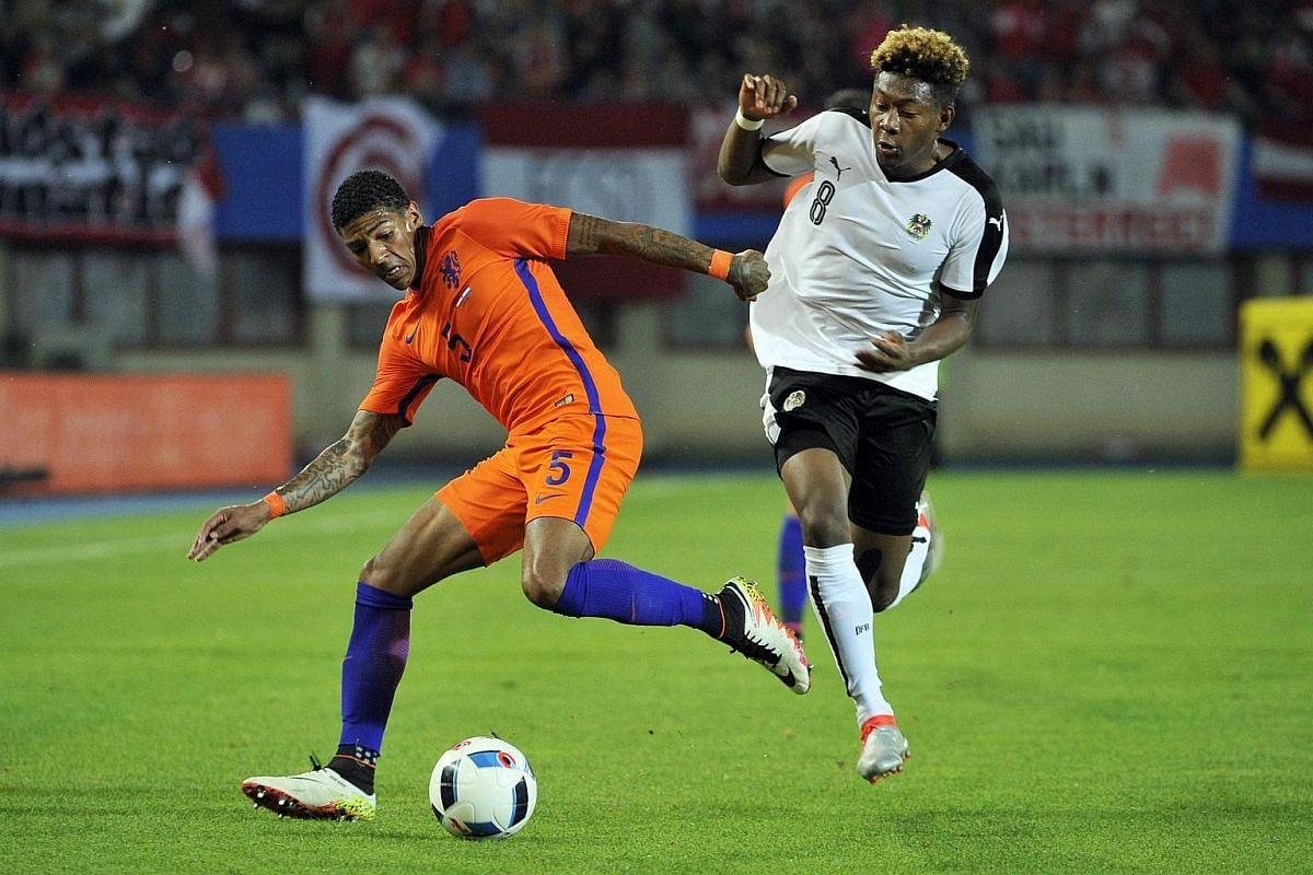 Austria's David Alaba (right) and Patrick van Aanholt of the Netherlands vying during a friendly match at Ernst Happel stadium in Vienna on June 4, 2016.