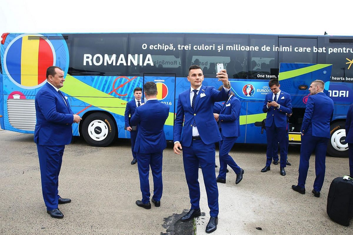 Romania's Ovidiu Hoban taking a selfie as he arrives with teammates at the Roissy-Charles de Gaulle airport on June 6, 2016.