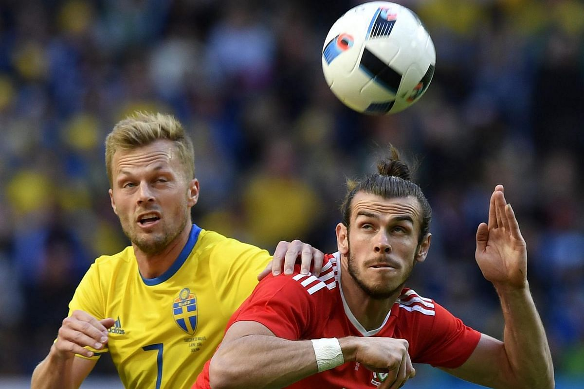 Sweden's Sebastian Larsson (left) and Wales' Gareth Bale in action during a friendly match at the Friends Arena in Stockholm, Sweden, on June 5, 2016.