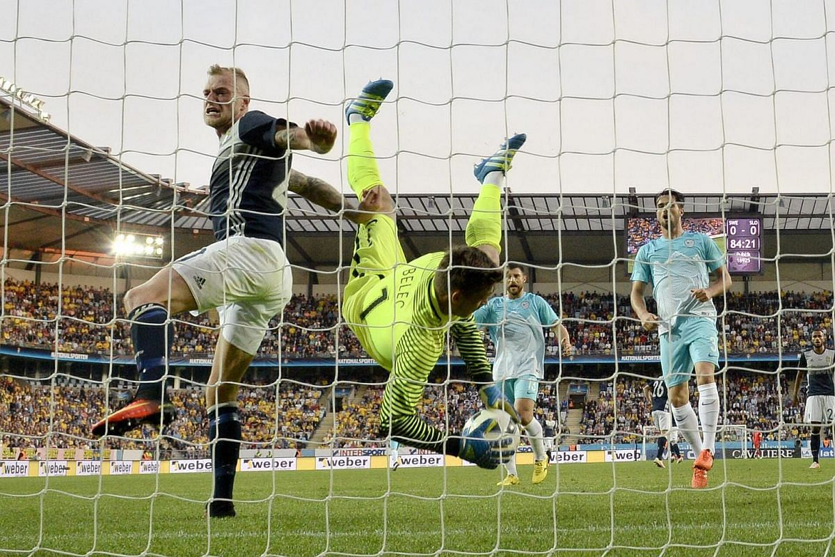 Slovenia's goalkeeper Vid Belec (centre) making a save against Sweden during a friendly match at Swedbank Stadion in Malmo, Sweden, on May 30, 2016.