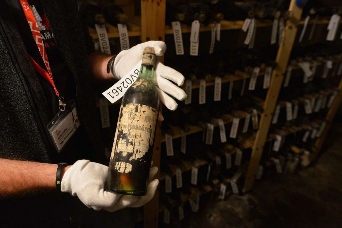 Tomas Wizovsky, castellan at the Becov castle takes a bottle of 19th-century wine out of the shelf in a cellar of Becov castle, on May 30, 2016 in Becov nad Teplou village, Western Bohemia.