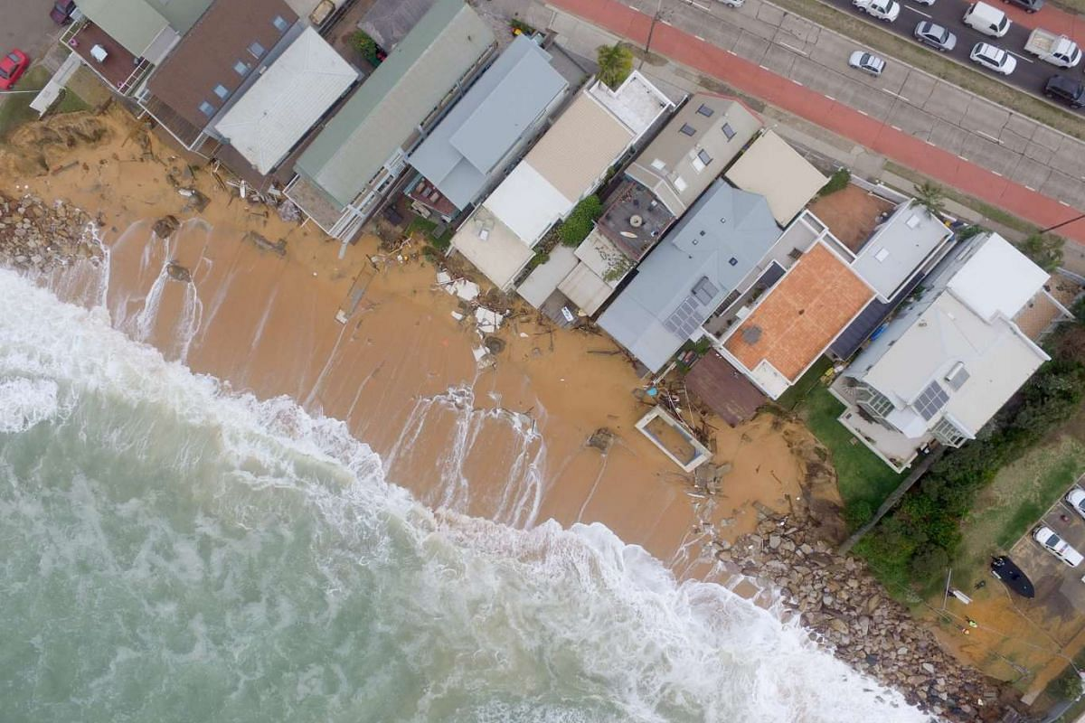 A handout photo from the University of New South Wales Water Research Laboratory shows an aerial view of the devastation caused by severe storms at Collaroy on Sydney's northern beaches, New South Wales, Australia on June 7, 2016.