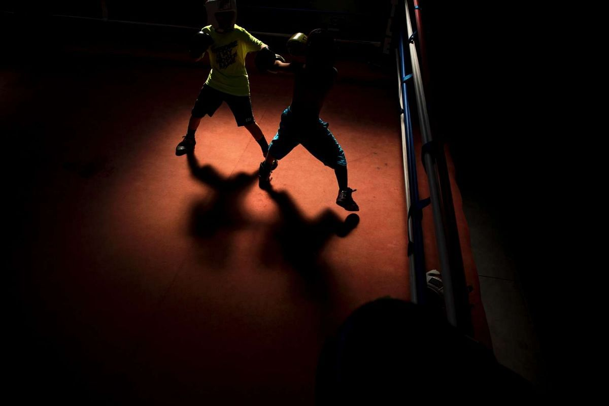 Students spar at the Louisville TKO Boxing Gymnasium on June 7, 2016 in Louisville, Kentucky.