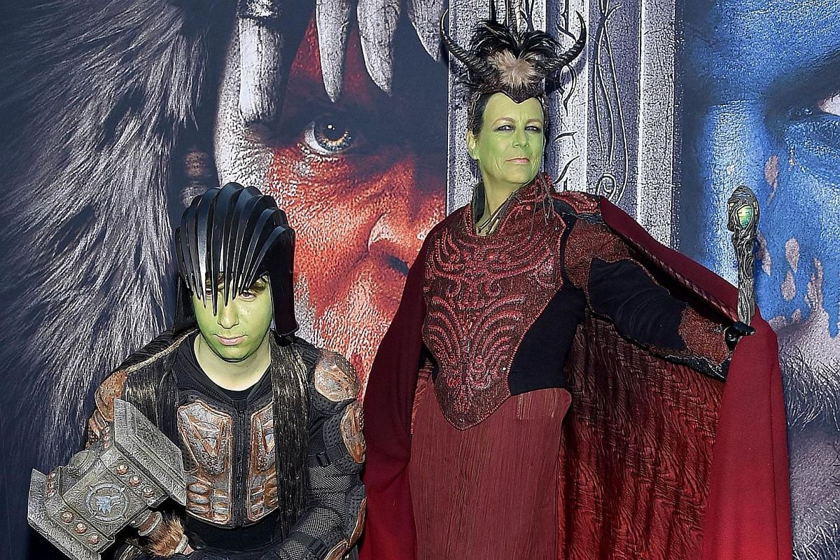 Actress Jamie Lee Curtis (right), dressed in full cosplay regalia as a member of the Orcish horde, with her similarly-togged out son Thomas Guest at the Warcraft premiere.