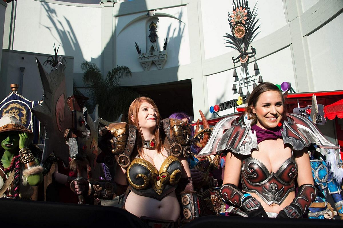 Fans dress for the theme at the premiere of Warcraft.