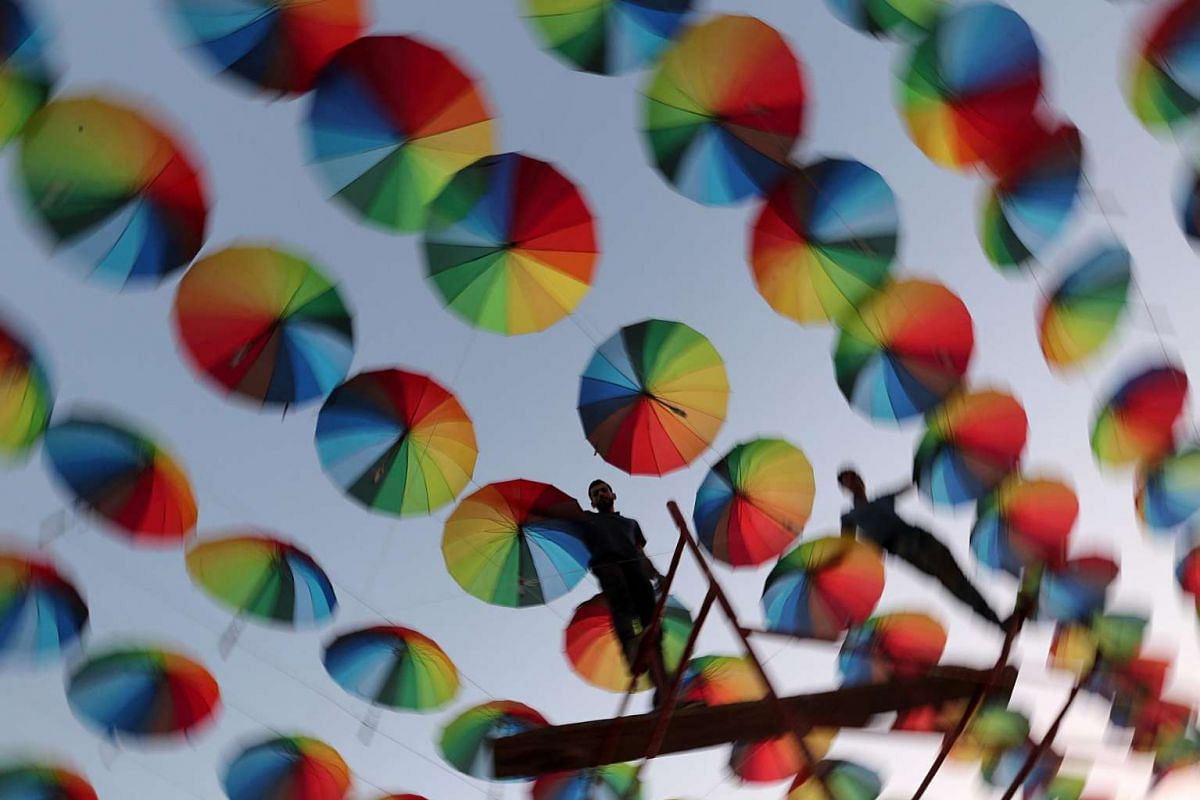 Palestinians Muslims decorate the streets with colourful umbrellas as they celebrate the Muslim holy month of Ramadan in Gaza City on June 8, 2016.