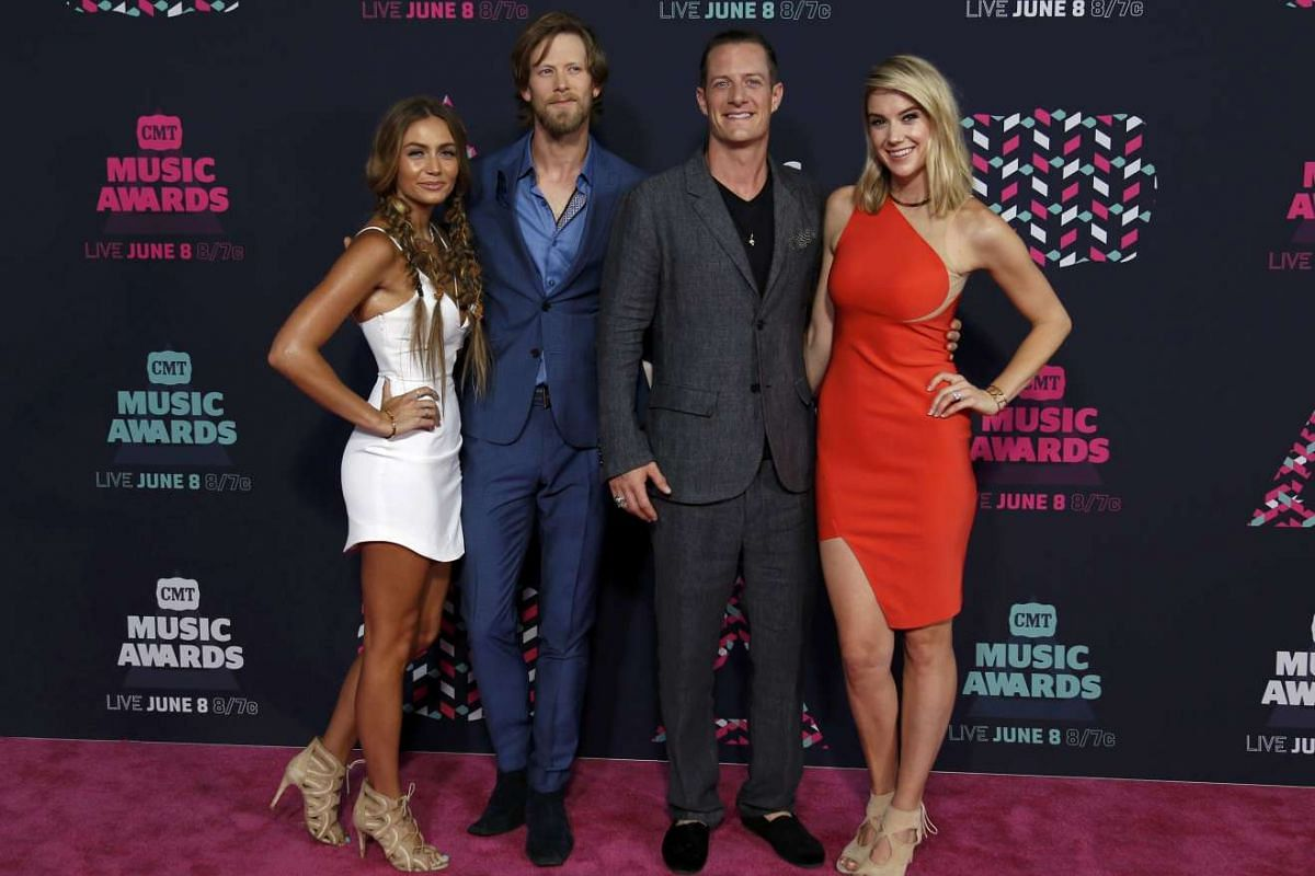 Florida Georgia Line members Brian Kelley (left) with his wife, Brittney Marie Cole, and Tyler Hubbard with his wife, Hayley Stommel, at the 2016 CMT Music Awards in Nashville, Tennessee, US, on June 8.
