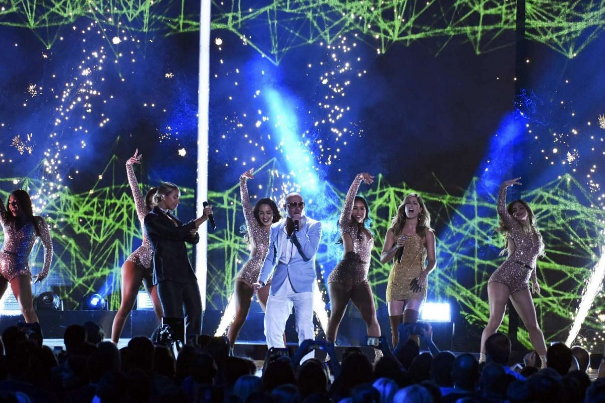 Singer Pitbull with Leona Lewis (left) and Cassadee Pope perform during the 2016 CMT Music Awards in Nashville, Tennessee US on June 8.