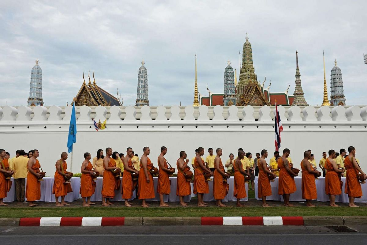 Buddhist monks walk towards The Grand Palace during the commemoration of the 70th anniversary of Thailand's King Bhumibol Adulyadej's reign in Bangkok on June 9, 2016.
