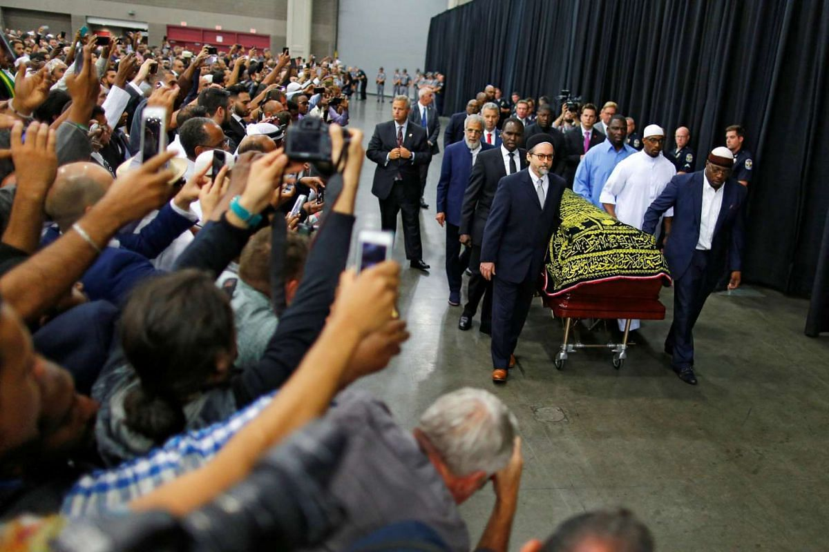 The casket with the body of the late Muhammad Ali is brought for his jenazah, an Islamic funeral prayer, in Louisville, Kentucky, on June 9, 2016.