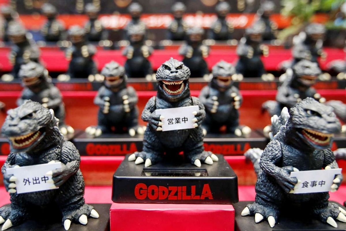 Folcart's Godzilla Solar Mascots are displayed at the International Tokyo Toy Show in Tokyo, Japan on June 9, 2016.