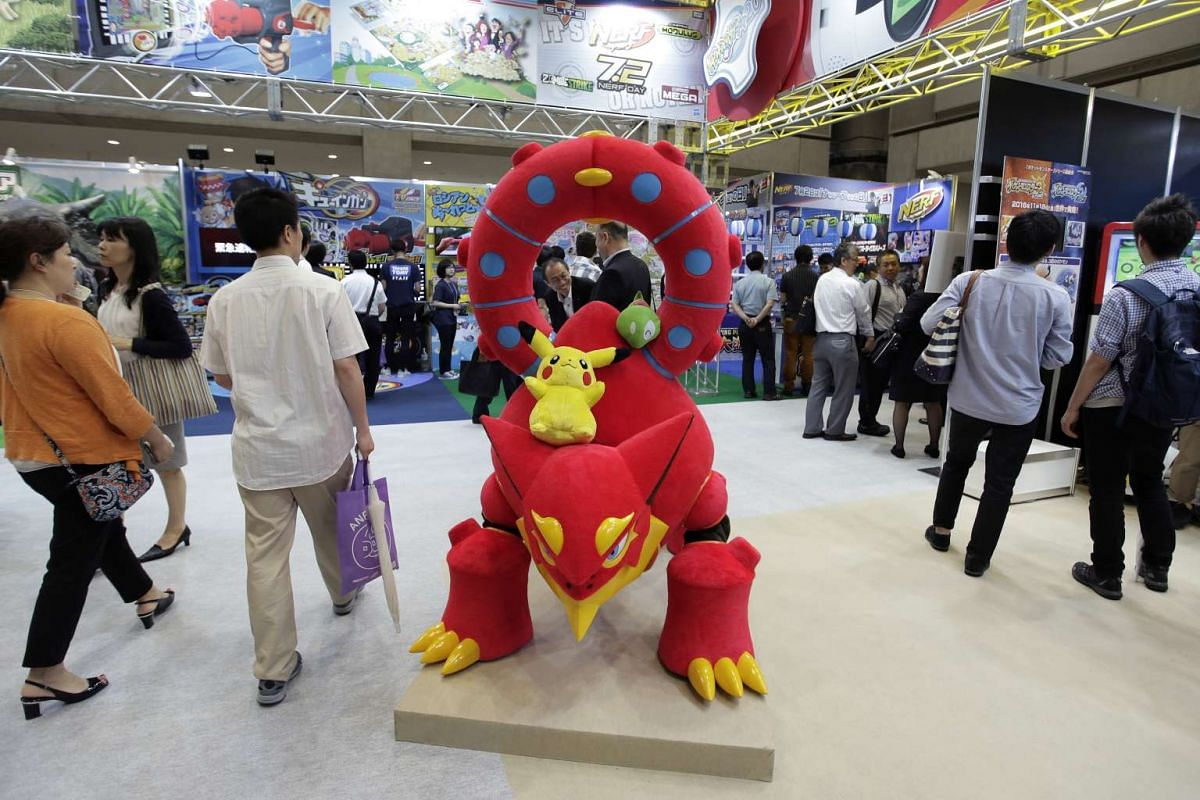 A character costume of Volcanion and a plush toy of Pikachu, characters from a Pokemon movie, are displayed at the Tomy booth at the International Tokyo Toy Show in Tokyo, Japan on June 9, 2016.