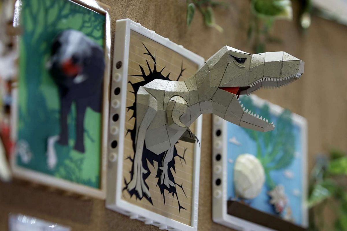A paper craft model of a dinosaur created using Kawada's paper nano is displayed at the International Tokyo Toy Show in Tokyo, Japan on June 9, 2016.