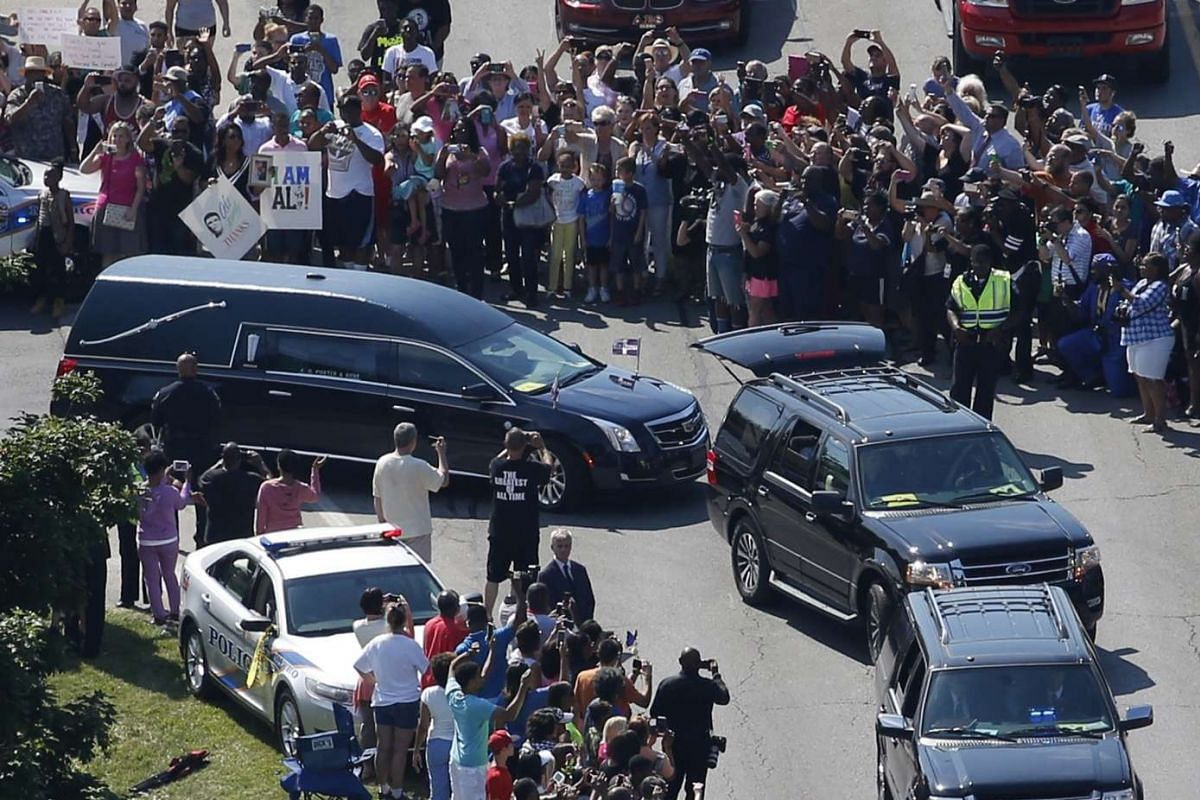 The hearse carrying the remains of Muhammad Ali leaves the funeral home.