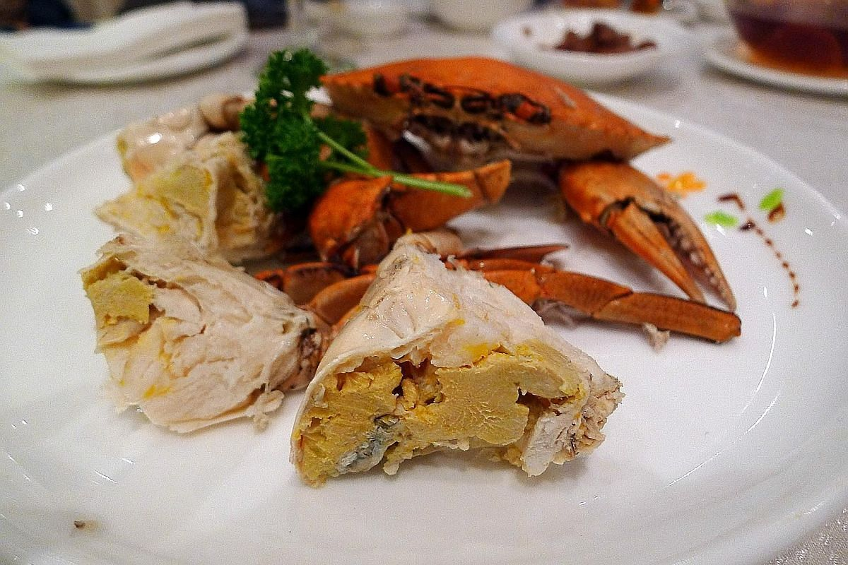 Crispy Oyster Omelette (above) is served with the oysters in a bowl of savoury-sweet sauce; Teochew Cold Crab (below).