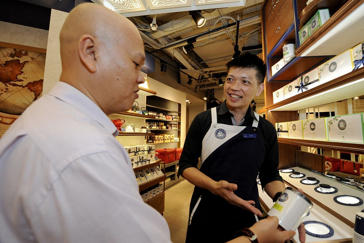 Leroy Lee (right), who has partial visual impairment, works as a retail sales associate where he introduces tea brands to customers.