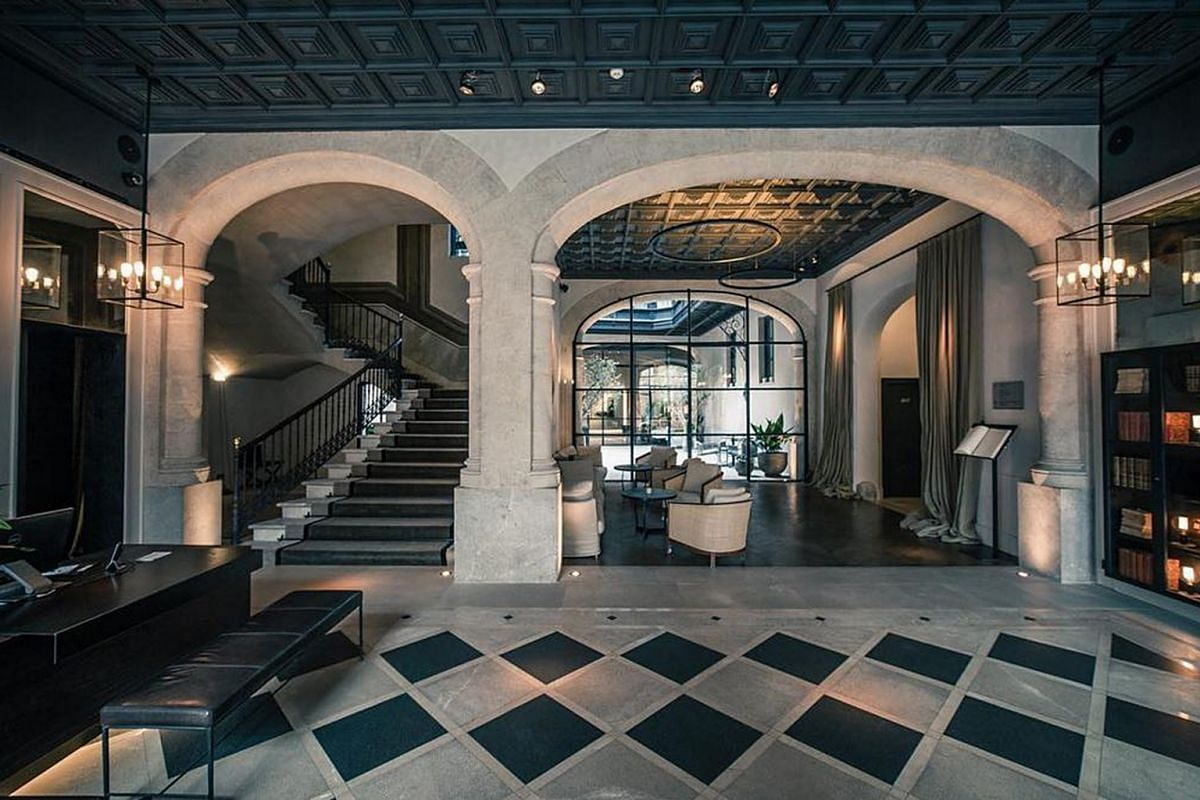 Well-designed interiors at the Sant Francesc Hotel Singular on Majorca (above) and the Pulitzer Amsterdam.