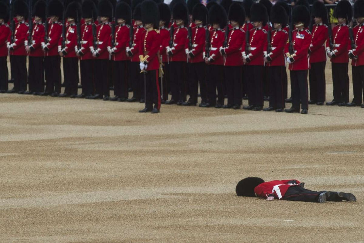 A guardsman collapses during the Trooping of the Colour Queen's 90th birthday parade on Horse Guards Parade, central London, Britain, on June 11, 2016. The annual Queen's Birthday Parade is more popularly known as Trooping the Colour, when the Quee