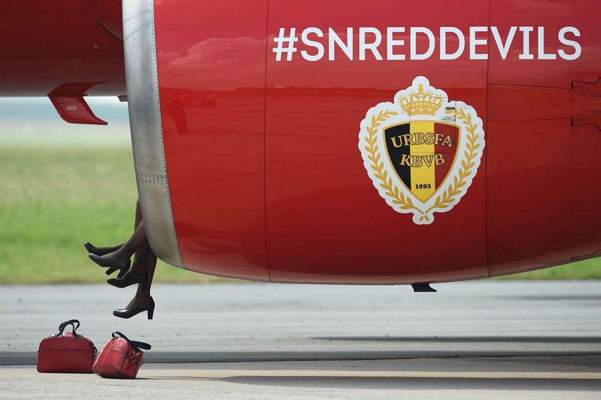Hostesses sit in the turbine of Belgium's national football team's plane prior to take off, en route to Bordeaux in France, at Zaventem airport, on June 7, 2016.