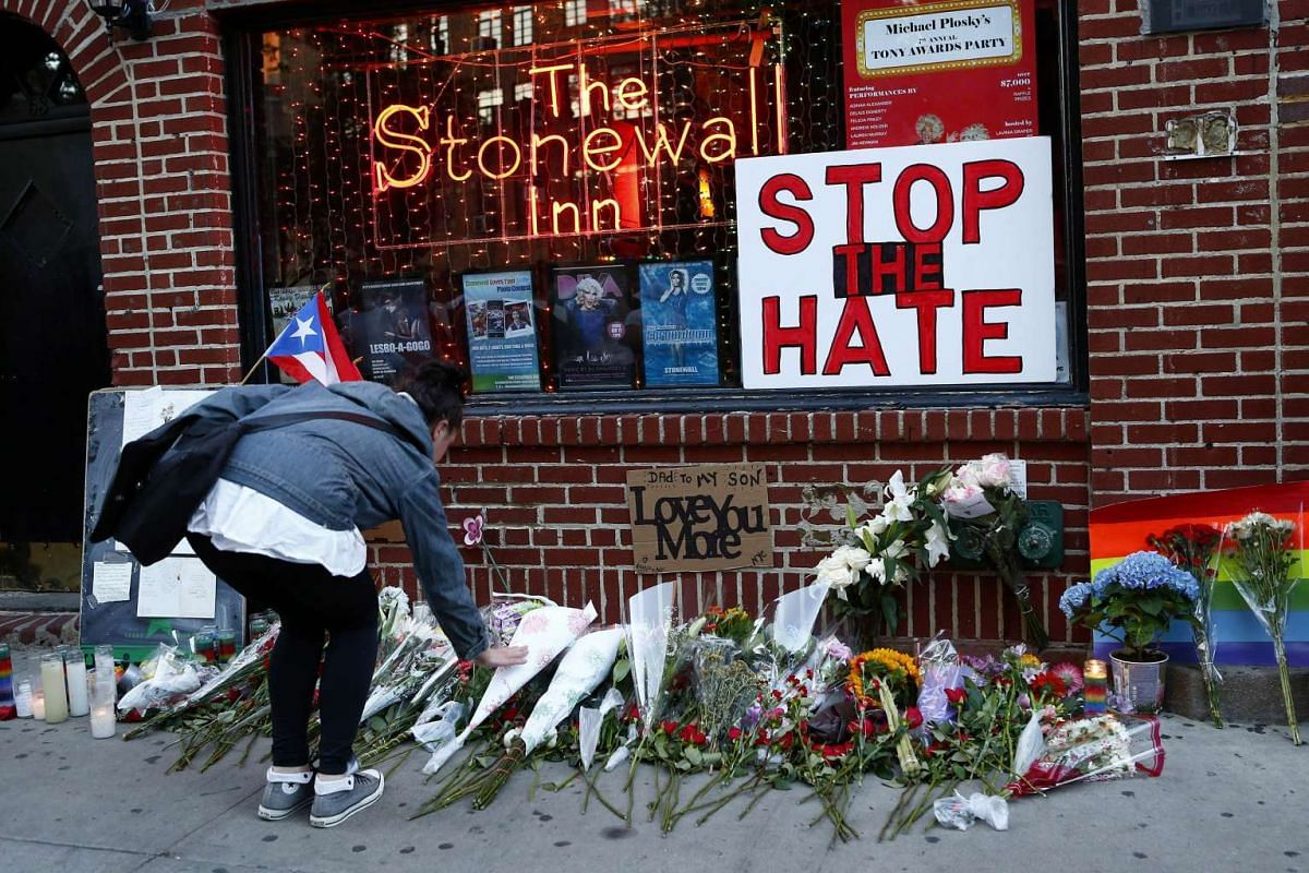 Flowers are placed at a makeshift memorial in front of the Stonewall Inn in New York City where a vigil was held following the Orlando nightclub shooting on June 12, 2016 .